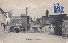 High Street, now known as Broad Street, Boxford c1914 This postcard shows the Maltings, which if you look closely are continued on the opposite side of the road where today only the lower half of the wall remains. The White Hart has it's railings and original sign and an extension to the front. The Fleece has a canopy over the window.