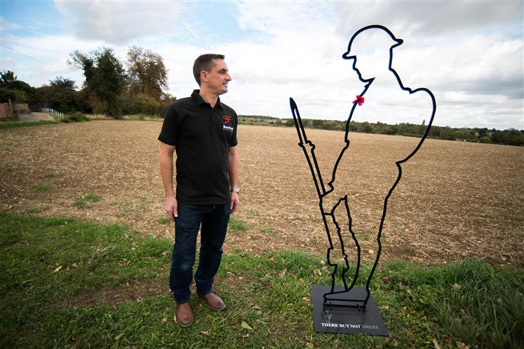 Lifesize sculpture of 'Tommy' to mark centenary of end of WW1. Alan Leeder (butcher from Boxford) with life-size ??Tommy outline sculptures to mark the 100 years since the end of WW1.